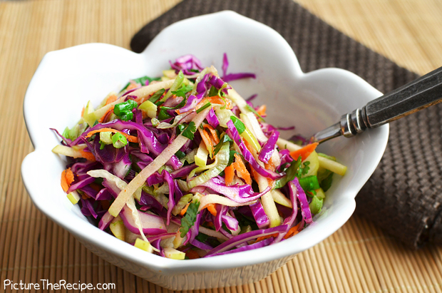 This is crisp refreshing salad, perfect for a hot summer evening. The cabbage is shredded, the snow peas blanched, the carrots and peppers julienned, and the green onion diced. Everything is tossed with a vinegar and oil dressing and chilled.
