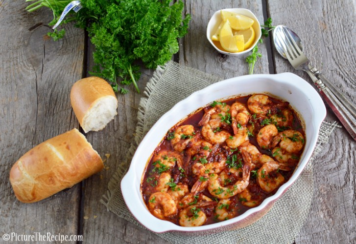 Spicy BBQ Shrimp- Bold, spicy, buttery and messy…this drool-worthy shrimp dish is just the thing to satisfy winter cravings! | PictureTheRecipe.com