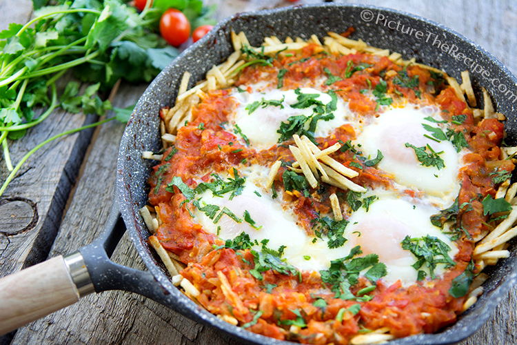Indian style shakshouka on crispy potato straws parsi sali par edu in sali par edu sometimes the tomato mixture is mixed in with the crispy fried potato sticks rather than layered and the eggs are beaten and poured over forumfinder